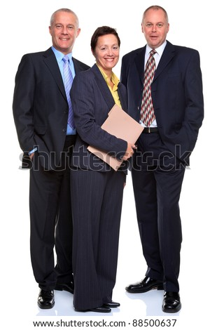 Photo of a mature business team consisting of two men and a woman who's holding a file, full length and isolated on a white background.