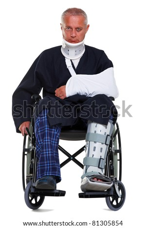 Photo of a mature male with various injuries in a wheelchair, he's wearing a neck brace, arm sling and leg cast and has a black eye, isolated on a white background. - stock photo