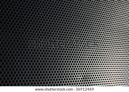 photo of a metal background with circles - stock photo