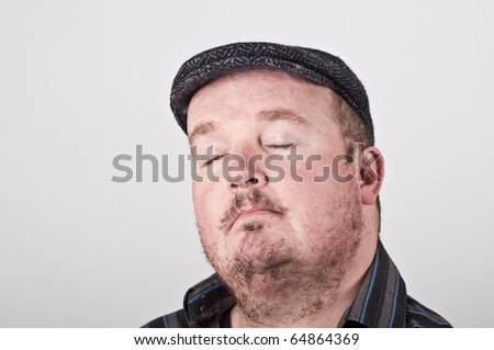 photo of a middle age male portrait on off white backdrop - stock photo