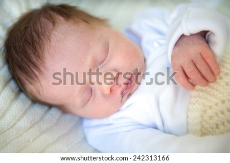 Photo of a newborn baby who sleeps