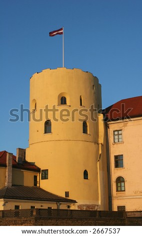 Photo of a Riga castle. Old tower against the blue sky. The castle is a residence for a president of Latvia (Riga, Latvia)