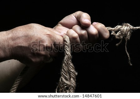 photo of a rope with hand pulling - stock photo