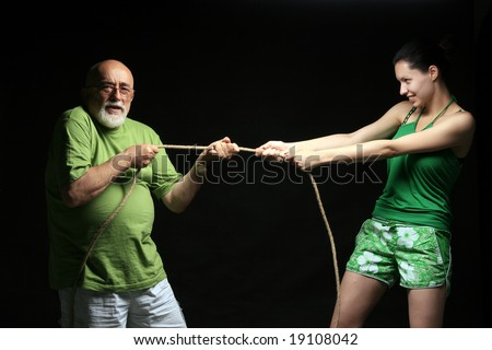 photo of a rope with two people pulling