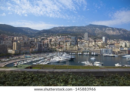 Photo of a row of yachts in Monaco Port, from a window of the car, Monte Carlo - stock photo