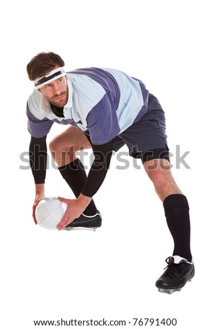 Photo of a rugby player passing the ball, cut out on a white background.