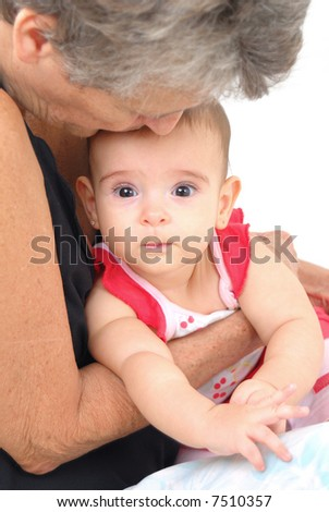 Photo of a Senior kissing the Baby . - stock photo