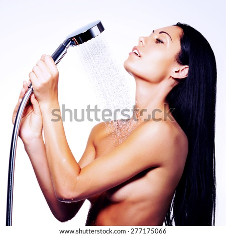 Photo of a sexy beautiful woman in shower washing body  - stock photo