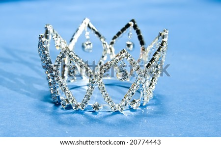 Photo of a silver crown in blue background - stock photo