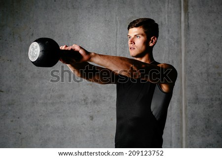 Photo of a sportsman exercising with a weight - stock photo
