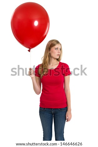 Photo of a teenage female with long blond hair posing with a blank red shirt and holding a blank red balloon.  Ready for you to add your artwork or designs.