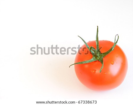 Photo of a tomato isolated on white background - stock photo
