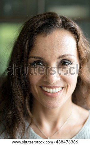 Photo of a very attractive 40-year-old woman with brown hair and eyes.