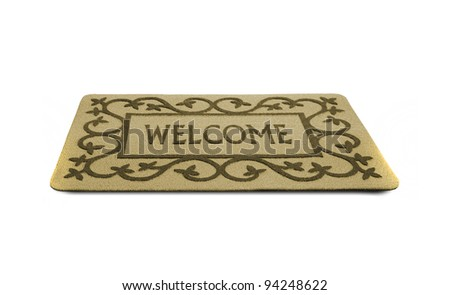 Photo of a welcome door mat isolated on a white background. - stock photo