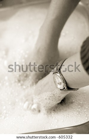 Photo of a woman hand washing in the kitchen sink