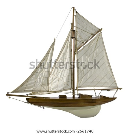 Photo of a wood replica of a sailing boat isolated on white background. - stock photo