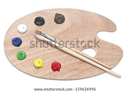 Photo of a wooden artists palette loaded with various colorful paints and brush, isolated on a white background  - stock photo