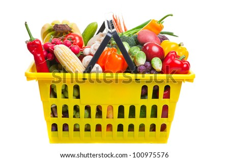 Photo of a yellow shopping basket full of fresh fruit and vegetables, isolated on a white background. - stock photo