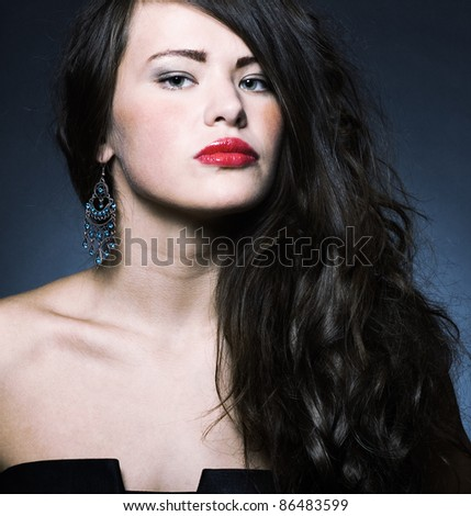 Photo of a young beautiful woman with bright makeup - stock photo