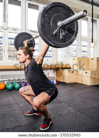 Photo young man crossfit gym lifting stock photo 370533965 photo of a young man at a crossfit gym lifting a barbell platinumwayz