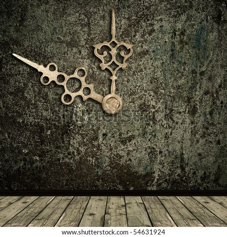 Photo of abstract grunge shabby interior with golden clock hands - stock photo