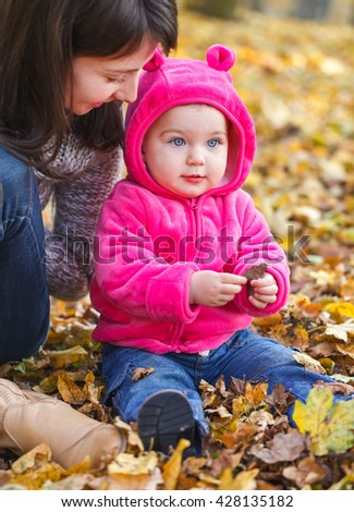 Photo of adorable baby girl with her mother - stock photo