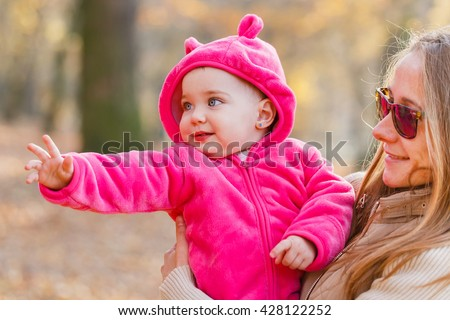 Photo of adorable baby girl with the babysitter - stock photo