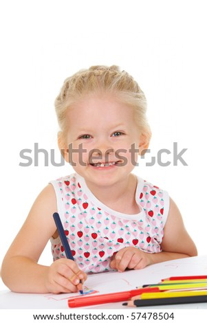 Photo of adorable girl looking at camera while drawing with colorful pencils - stock photo