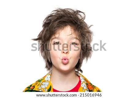 Photo of adorable young boy with kissing lips looking at camera. - stock photo
