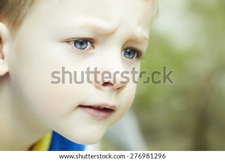 Photo of adorable young funny boy. Outdoor face of child - stock photo