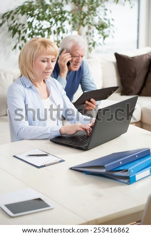 Photo of aged businesspeople working at home - stock photo