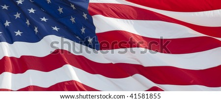 Photo of American flag waving in the wind - stock photo