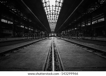 Photo of an Abandoned industrial interior with bright light - stock photo