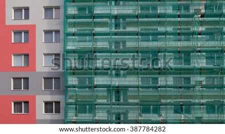 photo of an apartment building with scaffolding