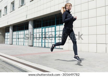 Photo of an athletic woman doing fitness - stock photo