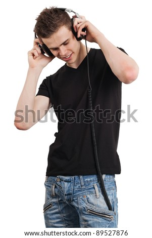 Photo of an attractive man smiling while listening to headphones.  Isolated on white. - stock photo