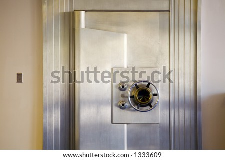 Photo of an attractive, vintage bank safe - stock photo