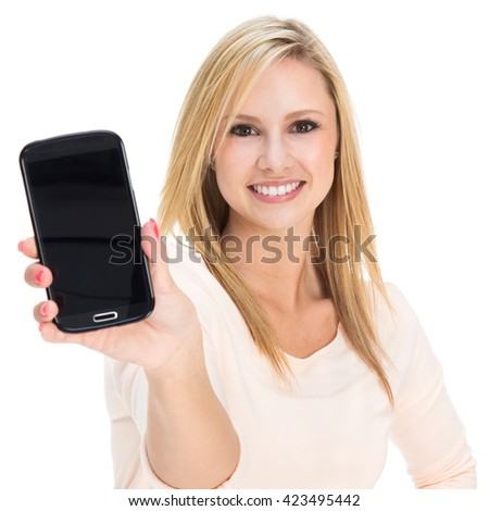 Photo of an attractive young blonde woman presenting a large smartphone; isolated on white. - stock photo