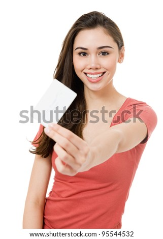 Photo of an casual young woman showing a blank white credit card (or gift card). Focus on face