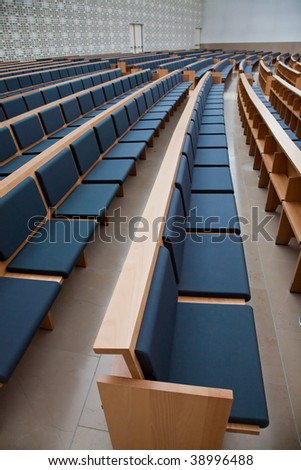 Photo of an empty auditorium with blue seats. - stock photo