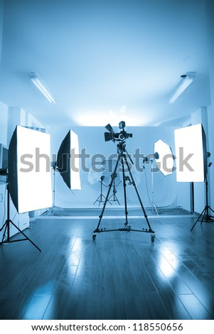 Photo of an empty photographic and video studio with modern lighting equipment. Color processed - stock photo