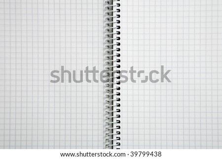 Photo of an empty spiral checked notebook