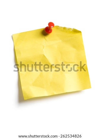 Photo of an isolated yellow sticky note pinned to a white background. - stock photo