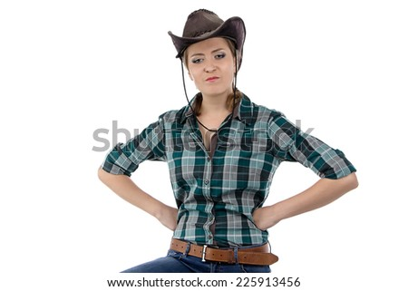 Photo of angry cowgirl on white background - stock photo