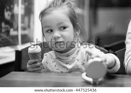 photo of baby girl looks suspiciously - stock photo