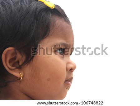 Photo of beautiful and charming happy indian girl child. The picture can be used to show the baby dreaming or the toddler imagining or as a visionary child, etc. The child is of pre-school age. - stock photo