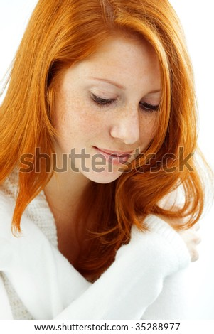 Photo of beautiful female with red hair and freckled skin on her face - stock photo