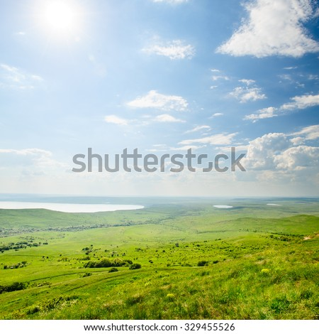 Photo of beautiful landscape with grassy and land lake under sunny skies