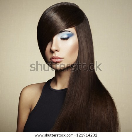 Photo of beautiful woman with magnificent hair. Fashion photo. Girl style