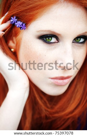 Photo of beautiful woman with red hair - stock photo